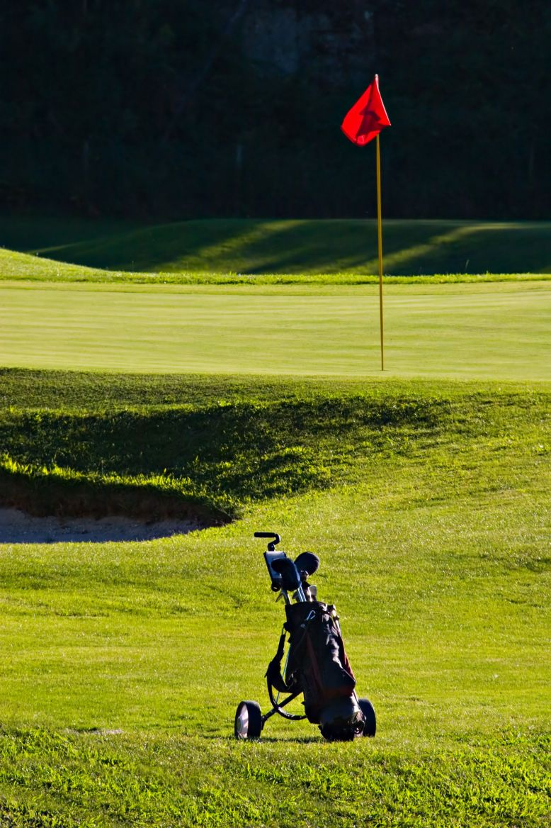 golf course flag and clubs photo